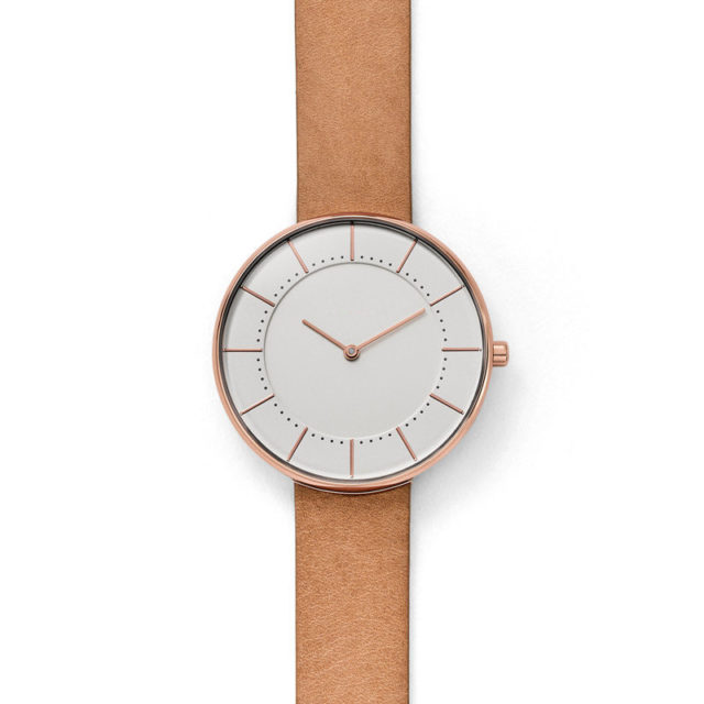rose gold case tan leather strap white dial watch