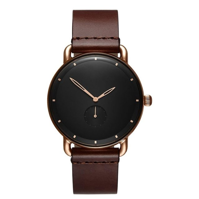 rose gold case brown leather strap black face watch