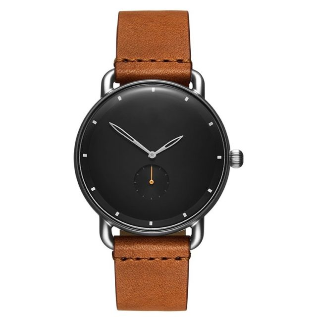 silver case tan leather strap black face watch